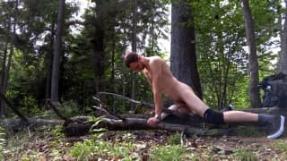 Naked horny guy in the woods fucking