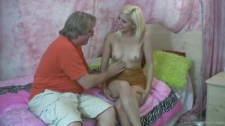 Pretty young blonde whore gets on her knees