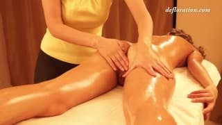 Brunette woman is covered in oil and fucked