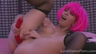 Fucks her pussy with a pink dildo and cums