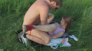 She takes a big dick in her ass in a field