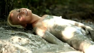 She loves jerking off in the mud outdoors