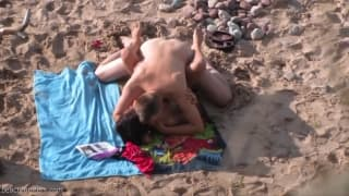 Spying on a horny couple fucking on the beach