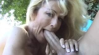 Mature blonde is horny and fucks in garden