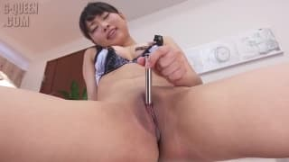 This pretty asian woman uses her toys