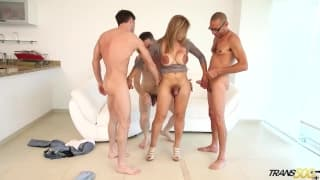 Sexy shemale with big tits in a gangbang