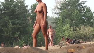 A naughty big tits plays naked on the beach