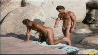 A group of guys all banging on the beach