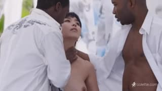 Tiny Asian girl takes two black cocks at once