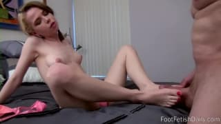 This babe loves to use her feet to wank him