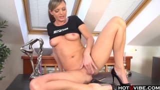 Cute blonde playing with her sex toy at home