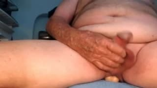 Old guy likes to stick a dildo in his cumhole