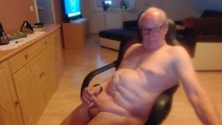 Here is an old man wanking in a char