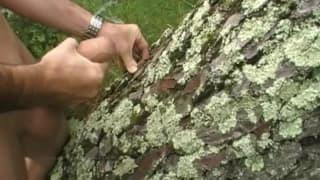 An old man masturbates his big cock in a wood