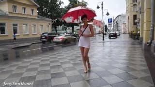 Jenny Smith gets wet in the rain in a dress
