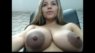 Sexy Latina shows off her huge natural tits