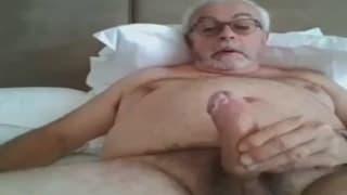 Old guy has a good time masturbating