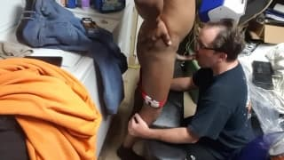 An older guy gets on his knees to suck