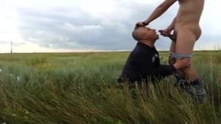 Watching a guy getting a BJ in a field