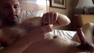 He is in the hotel feeling horny so he wanks