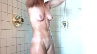 Pretty blonde loves to caress in the shower