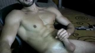 Sexy guy grabs his dick and wanks on cam