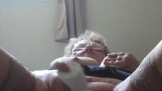 Old woman with hairy cunt fucks it in bed