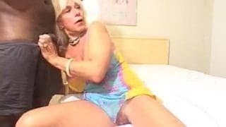Mature blonde takes a big black dick
