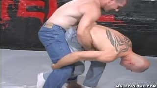 Guys in jeans wrestling to get close