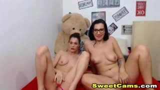 Naughty lesbians toying their tight pussies