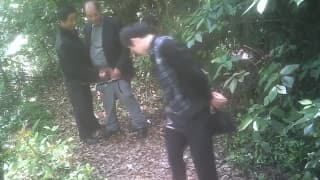 Old asian guys enjoy it in the forest