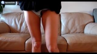 Blonde slut is legs open on the sofa