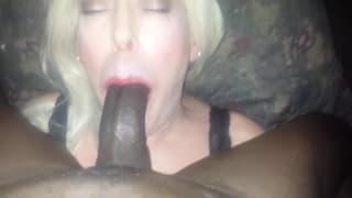 Dude in a blonde wig sucking black dick