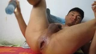 This brown guy fills his arse with all sorts
